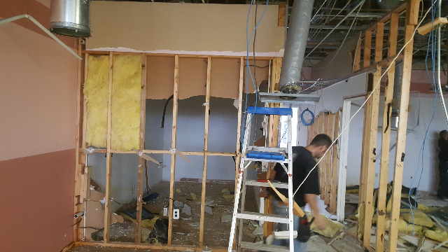 Tri-Star Roofing team demoing interior walls.