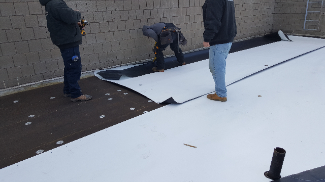 Installing the flashing on a roof in St. Clair, MI