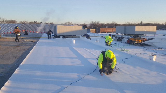 Tri-Star roofing team is kicking out field rolls.